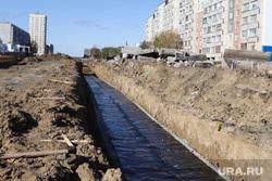 Строительные работы автодороги на проспекте Мальцева. Курган