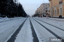 Город в снегу. Курган., дорога, зима