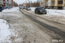 Очистка от снега центральных улиц города перед Советом безопасности. Курган., улица володарского, грязный снег, нечищенная дорога