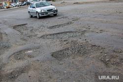 Состояние дорог города Кургана, разбитая дорога, улица коли мяготина, ямы в асфальте