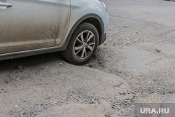 Состояние дорог города Кургана, колесо автомобиля