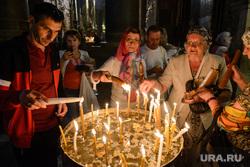 Виды Тель-Авива, Ашдода, Иерусалима. Израиль, свечи, верующие, христианство, религия, храм гроба господня