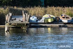 Виды Стокгольма. Швеция, пирс, лодка
