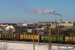 Виды города. Курган, тэц, железнодорожные пути, завод, поезд ржд, экология