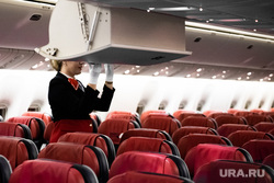 Флагманский самолет Boeing 777-300ER авиакомпании «AZUR air». Екатеринбург, воздушное судно, бортпроводник, пассажирский самолет, ручная кладь, самолет, стюардесса, авиакресла, борт самолета, авиаперевозки