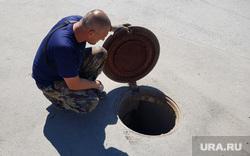 Виды Кургана, люк канализации, открытый люк