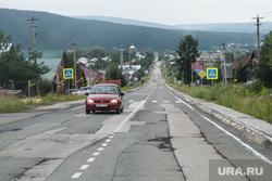 Последствия паводка в Нижних Сергах. Свердловская область, заплатка на асфальте, город нижние серги, старая дорога