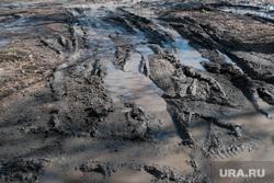 Завод КМЗ. Курган, слякоть, грунтовая дорога, грязь во дворе, лужи, грязь на дорогах, размытая дорога