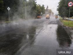 Дождь и асфальтоукладчики Челябинск, дорожники, асфальт