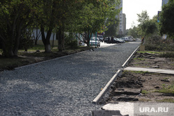 Ремонтные работы на  автодороге по проспекту Мальцева. Курган, тротуар, щебень гранит, ремонт дороги, щебень на пешеходной зоне